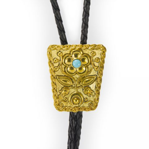 24k Yellow Gold plated over Sterling Silver. Ojibwe Flower Motif Bolo with braided sweetgrass border and a sleeping beauty turquoise, made by Louise Solomon from Hand of Solomon Native jewelry in Toronto Canada.