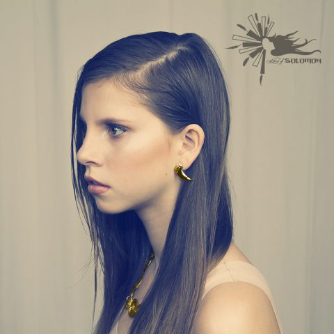 Yellow Gold Wolf Claw Earrings and Necklace.