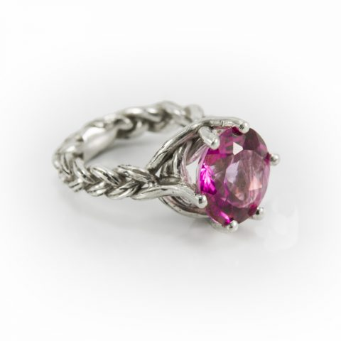 Braided Sweetgrass Engagement Ring in White Gold and 5ct Pink Topaz. Native jewelry brought to you by Hand of Solomon Jewellery. Designed by Louise Solomon Ojibwe artist from Toronto Canada.